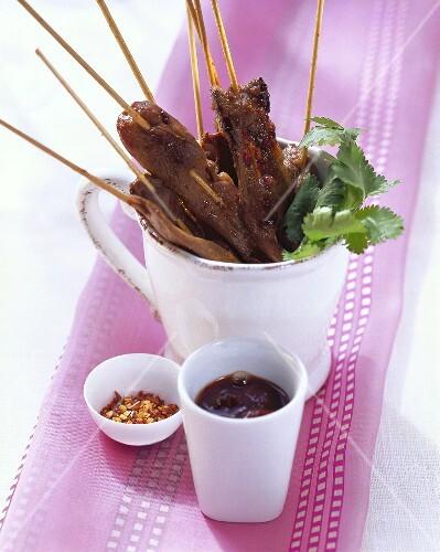 Duck saté; plum sauce; chili flakes