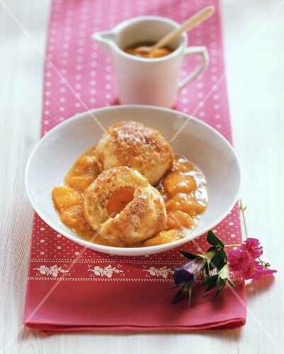Apricot dumplings with buttered breadcrumbs and apricot compote