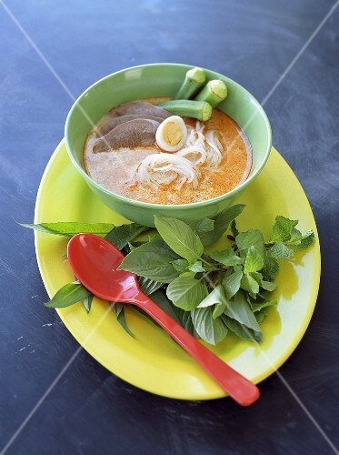 Curry laksa (noodle soup with meat, okra and egg, Malaysia)