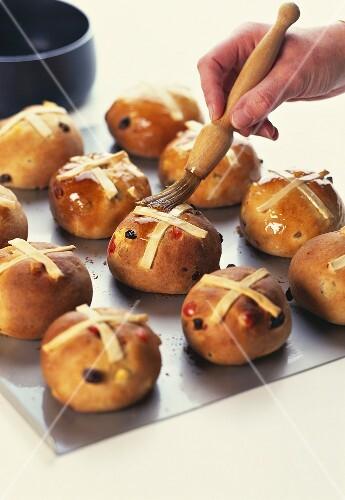 Spreading honey on sweet yeast rolls