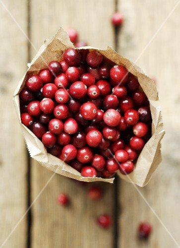 Cranberries in paper bag (overhead view)