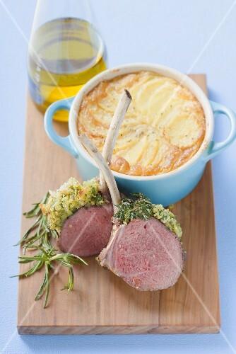 Lamb chops with herb crust, potato gratin, olive oil