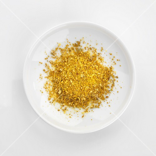 Curry powder in white dish (overhead view)