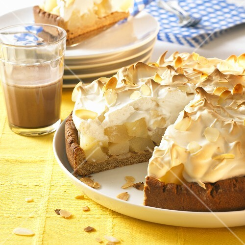 Pear meringue tart, a piece removed