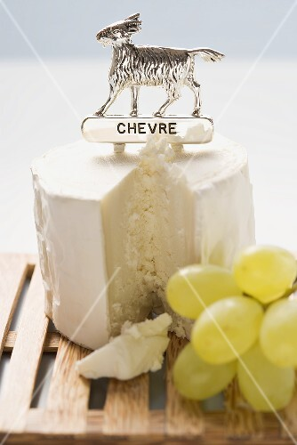 Chèvre (goat's cheese) with label, green grapes