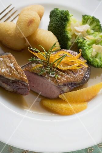 Duck breast with orange, potato croquettes and broccoli
