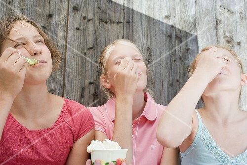 Three girls eating ice cream
