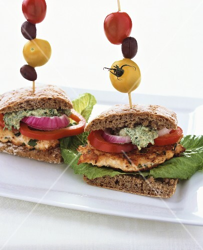 Salmon sandwiches with caper sauce and skewered vegetables