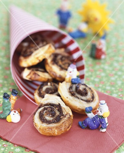 Nut buns for children on napkin and in paper cone