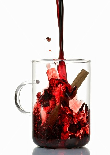 Pouring mulled wine into glass