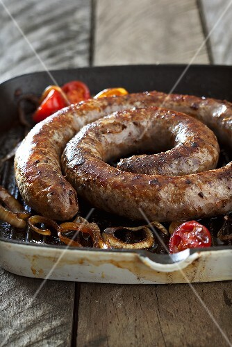 Boerewors (South African sausage) with onions and tomatoes