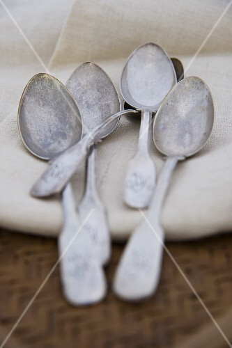 Old silver spoons on a fabric napkin
