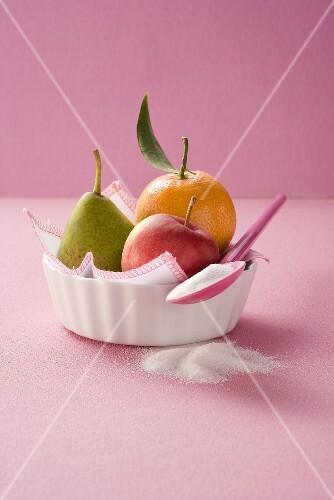 Apple, pear, orange and sugar