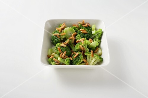 Preparing broccoli with pine nut butter