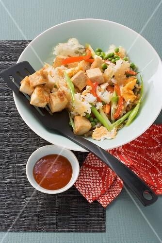 Three Bowls of Fried Rice with Tofu; Chopsticks
