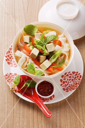 Rice noodle soup with red pepper and tofu