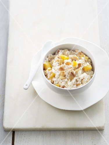 Sweet peach risotto with almonds