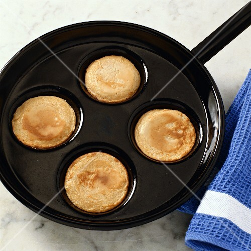 Frying a blini in frying pan