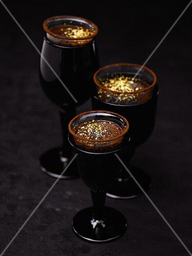 Chocolate cream with gold leaf in three glasses
