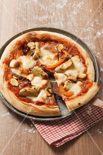 Pizza capricciosa (Ham and artichoke pizza)