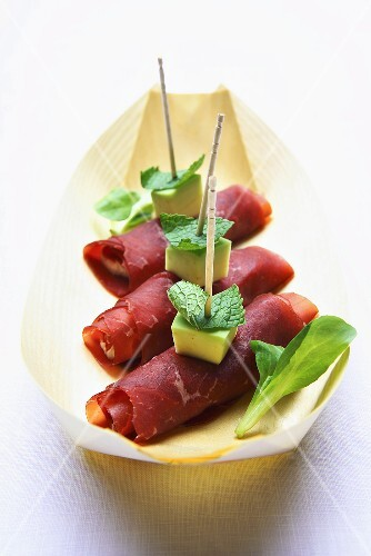 Bresaola rolls filled with avocado
