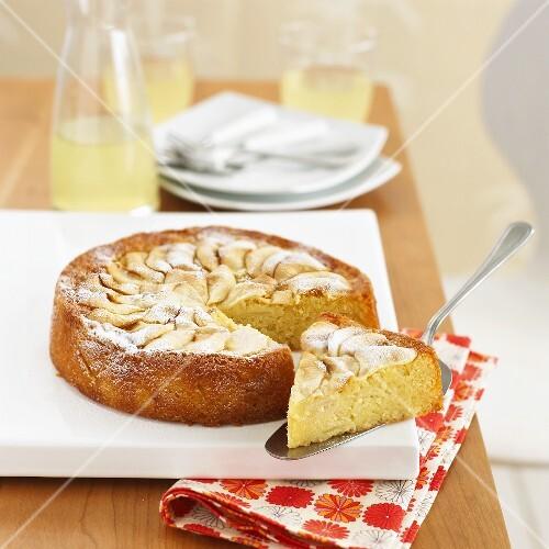 Apple and almond cake, a piece cut