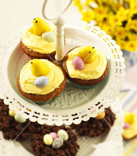 Cupcakes with Easter decorations on tiered stand