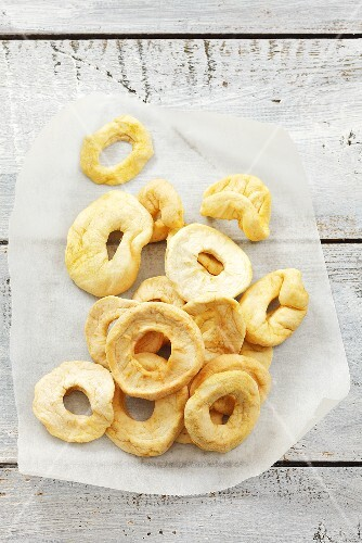 Dried apple rings on paper