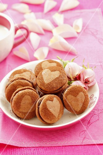 Chocolate macarons and pink roses