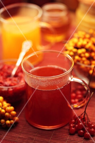 Hot drinks with sea buckthorn berries and guelder rose berries