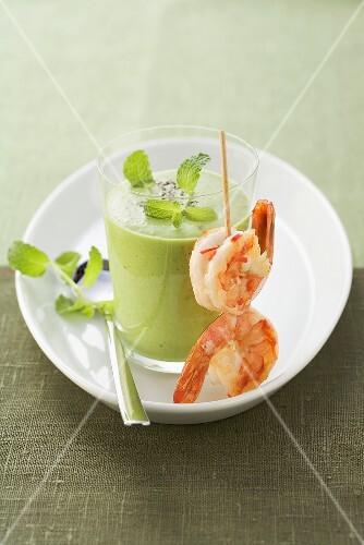 Pea soup with prawn skewer