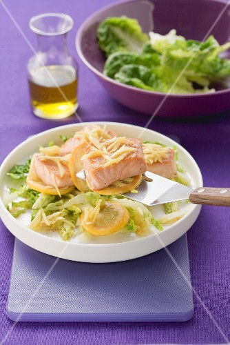Fried salmon with ginger and lemon and a green salad