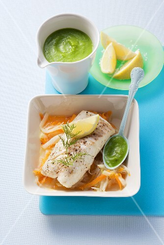 Cod on vegetables with pea sauce