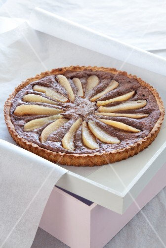 Chocolate tart with champagne pears