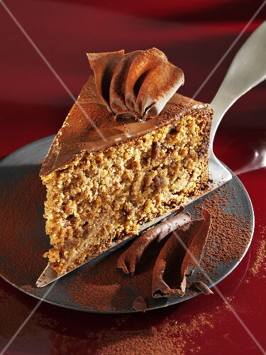 A piece of gingerbread cake on cake server