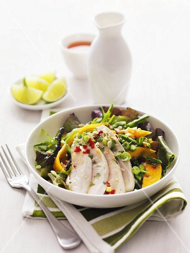 Salad with exotic fruit and chicken breast
