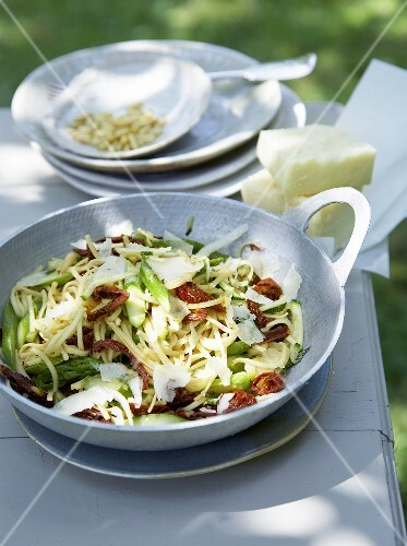Cheese salad with green asparagus and dried tomatoes