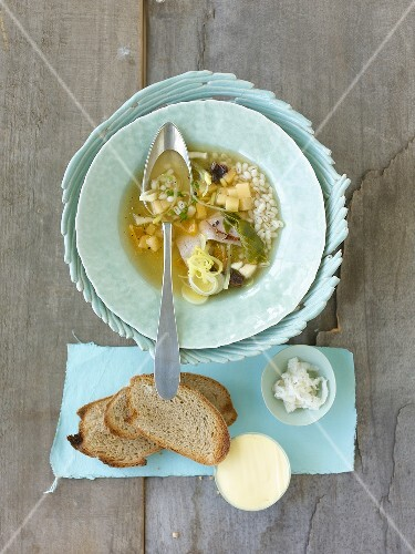 Swede soup with cured pork and dried fruit