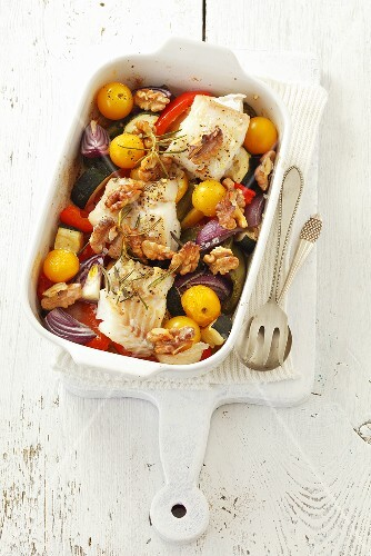 Cod with vegetables, walnuts and rosemary