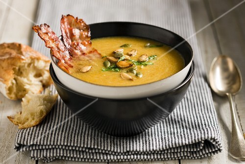Pumpkin soup with bacon and pumpkin seeds