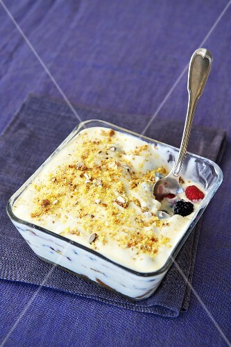 Berry trifle with white chocolate sauce and cantucci