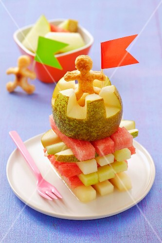 Tower of melon and pear with puff pastry men