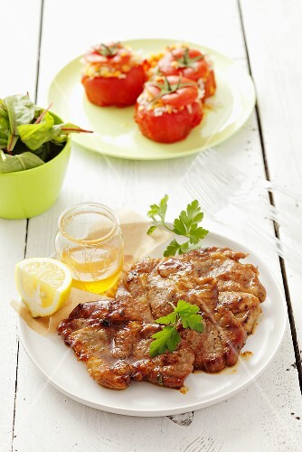 Barbecued pork neck steaks with honey marinade
