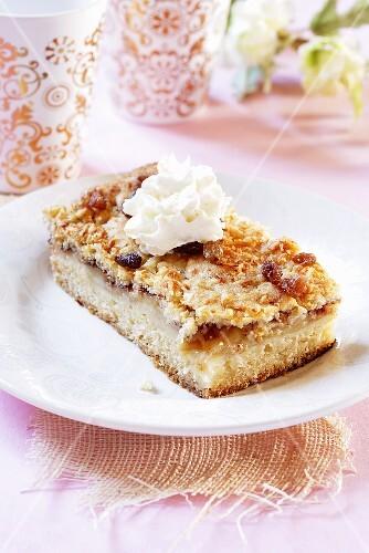 Piece of warm apple cake with cream
