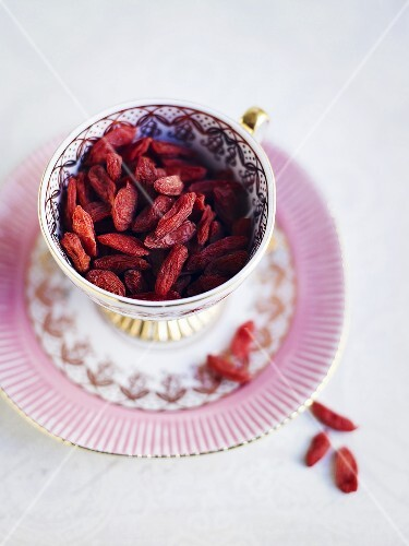 Goji berries in cup and saucer