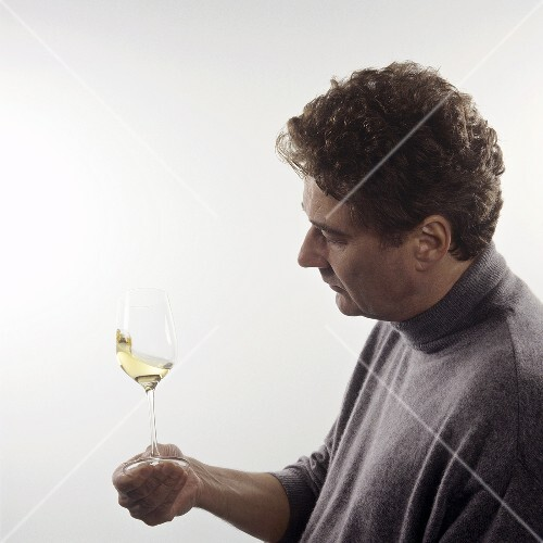 Swirling wine glass: oxygenating, checking consistency