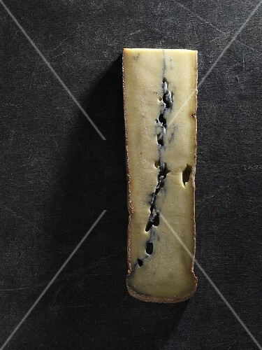 A piece of Morbier vieux cheese