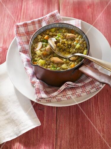 Lentil soup in an enamel pot