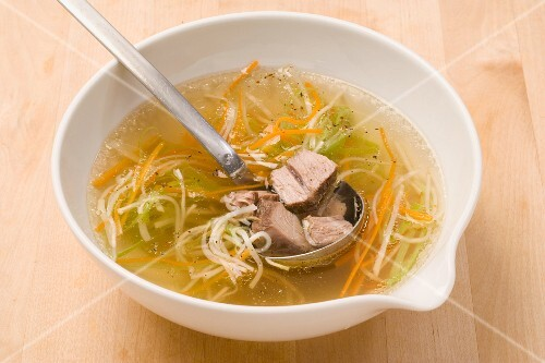 Beef broth with meat, vegetables and noodles