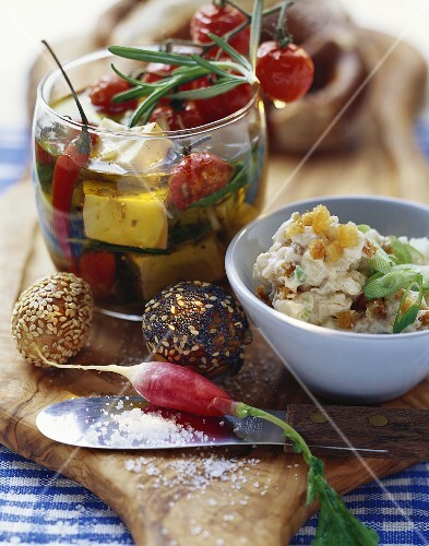 Pickled cheese, cheese spread with pears, radishes, rolls